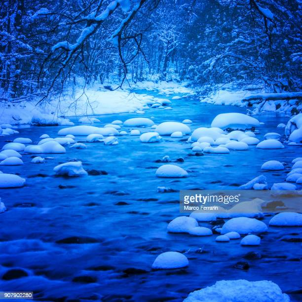 Mountain stream in Oirase with snow covered stones