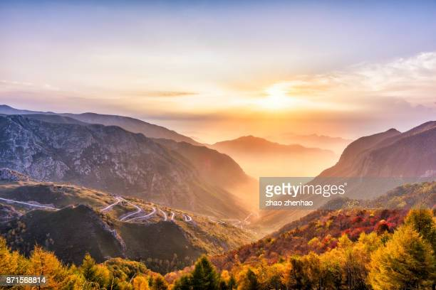 mountain sunrise - mountain road stock pictures, royalty-free photos & images
