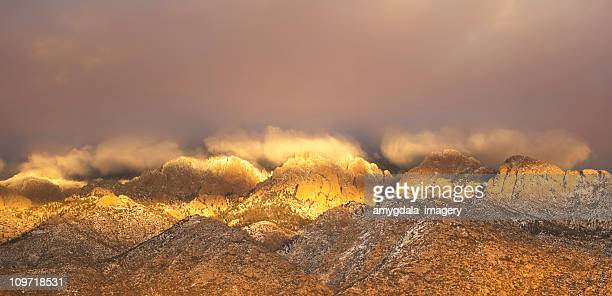 mountain sunset landscape - sandia mountains stock photos and pictures