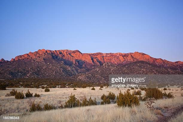 mountain sunset - sandia mountains stock pictures, royalty-free photos & images