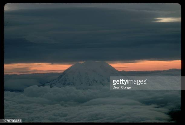 Mountain Top Protruding From Clouds