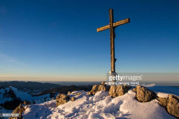 Mountain top with cross in winter
