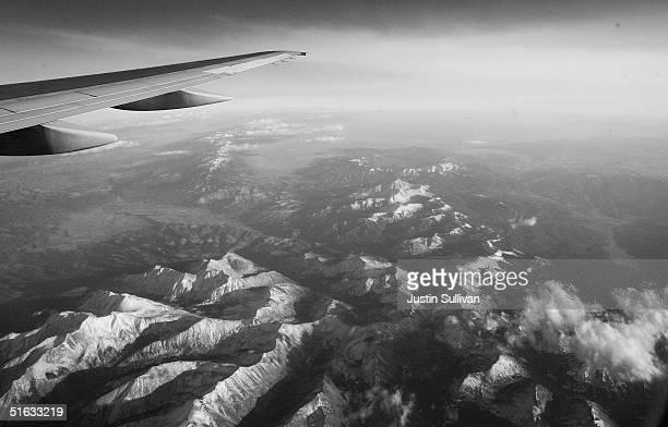 Mountain tops are seen October 20 2004 in flight