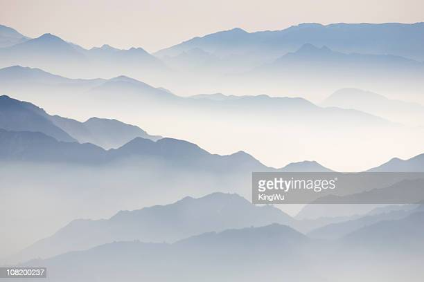 mountain tops in clouds - lotus flower peak stock pictures, royalty-free photos & images