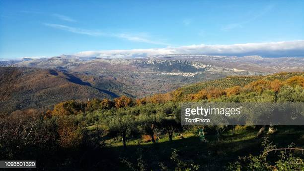 mountain valley landscape in autumn - basilicata region stock pictures, royalty-free photos & images