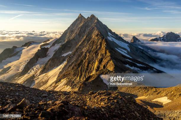 mountain view during sunrise on the way to the top of weissmies in switzerland - mountain ridge stock pictures, royalty-free photos & images