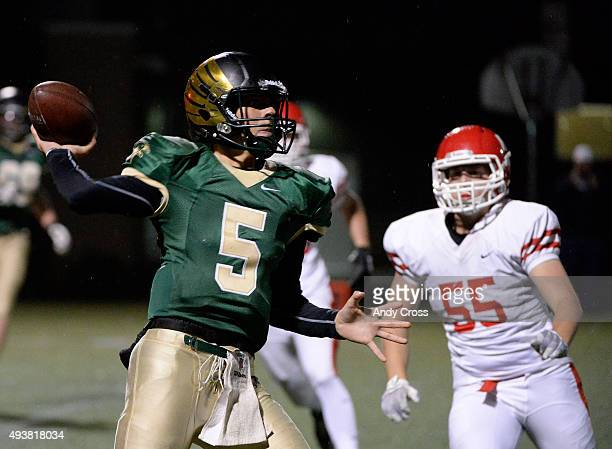 Mountain Vista QB Judd Erikson #5 throws under pressure by Regis Jesuit LB Will Kulick #55 in the first quarter at Shea Stadium October 22 2015 Photo...