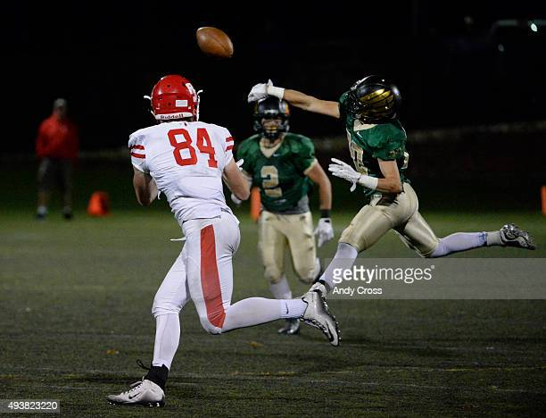 Mountain Vista safety Nick Capocelli #20 knocks the pass away from Regis Jesuit TE Jack Stoll in the third quarter at Shea Stadium October 22 2015...
