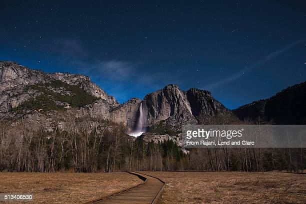 Mountain waterfall in a beautiful night
