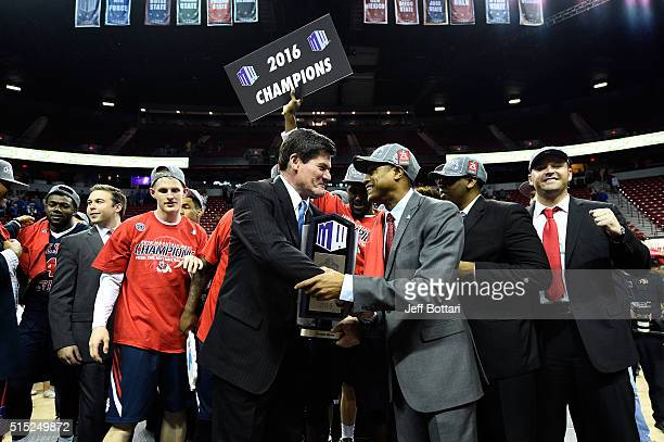 Mountain West Conference Commissioner Craig Thompson presents the Mountain West Conference championship trophy to head coach Rodney Terry of the...