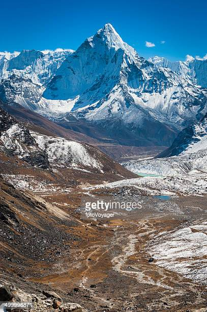 Mountain wilderness snowy peaks soaring over remote valleys Himalayas Nepal