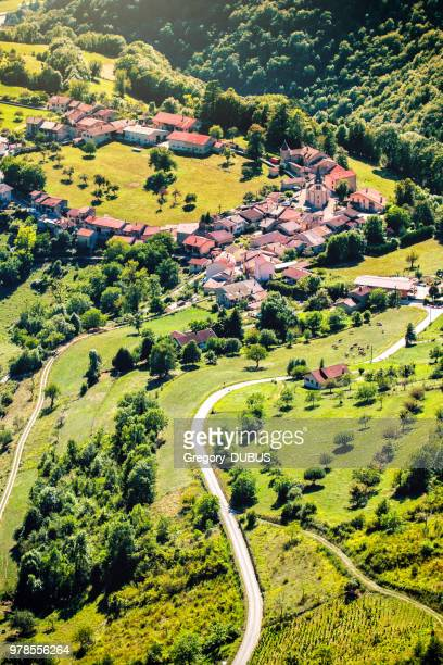 mountain winding road leading to old french village in circle shape in valley of bugey mountains in ain - ain france stock pictures, royalty-free photos & images