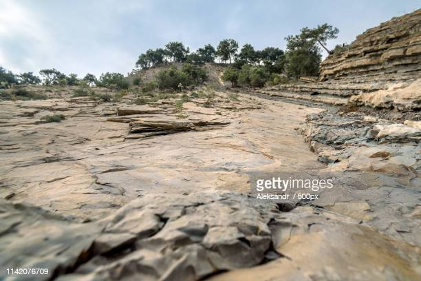 mountain with faults after rockfall bottom view - beautiful bare bottoms stock pictures, royalty-free photos & images