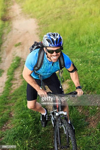 Mountainbiker climbing up on the mountain