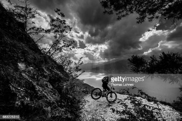 A Mountainbiker descends a trail on the slopes of 'Monte Altissimo' on May 12 2017 near Torbole Italy