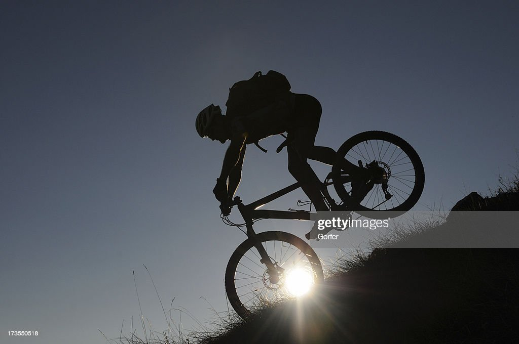 Mountainbiker in the evening : Stock Photo