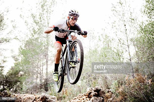 Mountainbiker jumping midair
