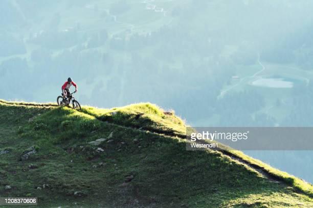 mountainbiker on a way in grisons, switzerland - kanton graubünden stock-fotos und bilder