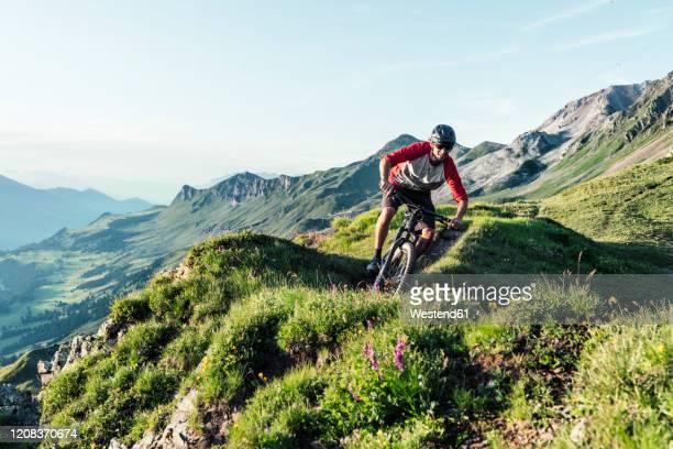 mountainbiker on a way in grisons, switzerland - レンツァーハイデ ストックフォトと画像