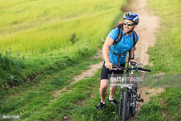 Mountainbiker riding on trail in grassland