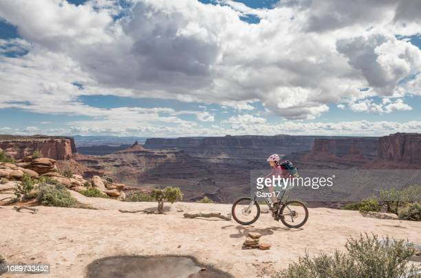 mountainbiking at dead horse point state park rim, moab, utah. - moab utah stock photos and pictures