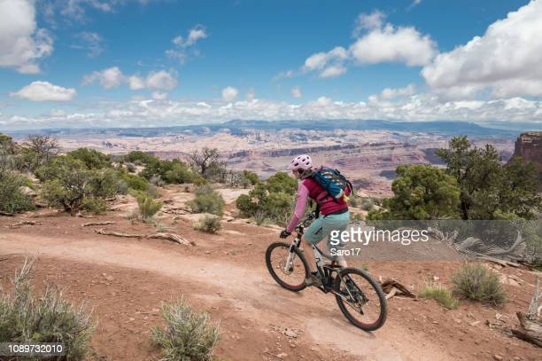 mountainbiking at dead horse point state park, utah. - dead horse point state park stock pictures, royalty-free photos & images