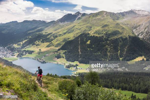 mountainbiking high above davos, switzerland. - davos stock pictures, royalty-free photos & images