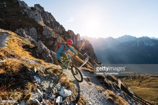 mountainbiking in the austrian alps - mountain bike stock pictures, royalty-free photos & images