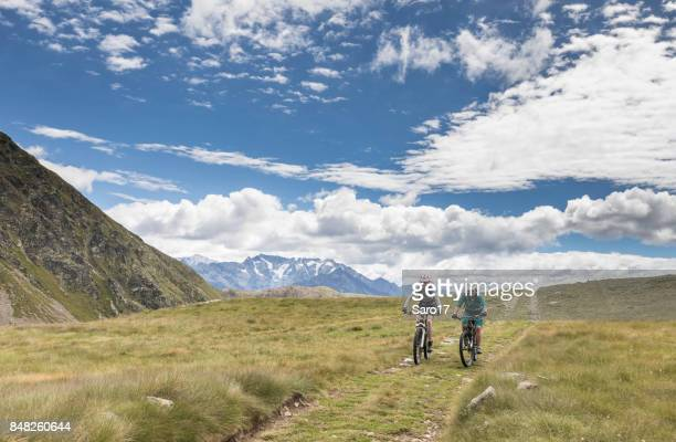 mountainbiking in the valtellin area, italy. - side by side stock photos and pictures