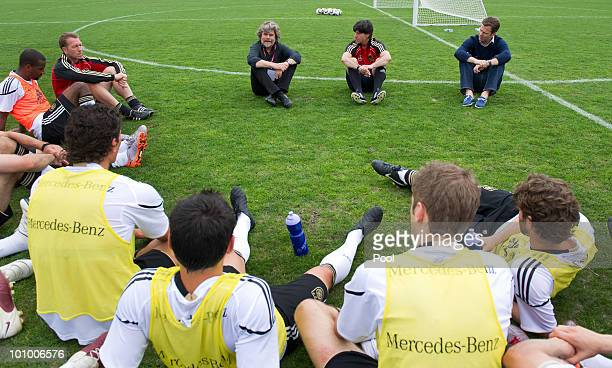 Mountaineer and explorer Reinhold Messner talks the the German national team sitting next to head coach Joachim Loew and team manager Oliver Bierhoff...