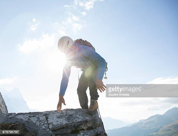 Mountaineer ascends final step on ridge crest