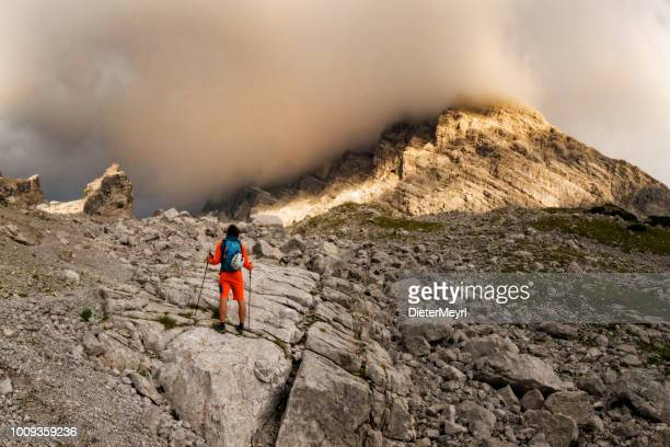mountaineer at sunrise on the way to the summit - berchtesgadener land stock photos and pictures