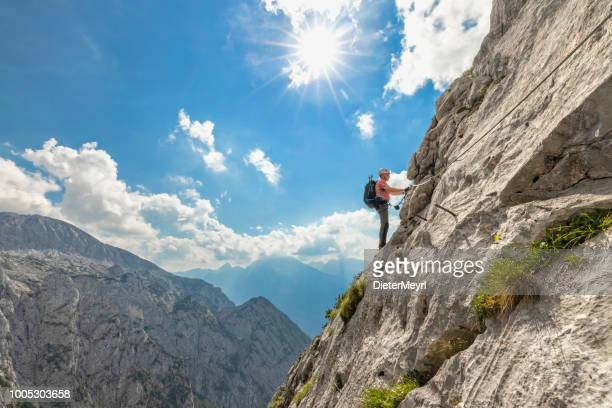mountaineer at via ferrata to mount hoher göll, nationalpark berchtesgaden - alps - bavarian alps stock pictures, royalty-free photos & images