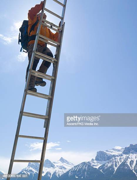 Mountaineer climbing ladder