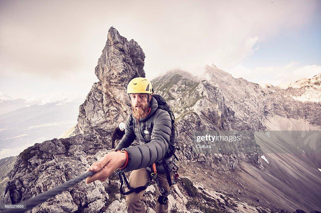 Klettersteig Innsbruck Umgebung : Mountaineer climbing mountain via ferrata klettersteig innsbruck
