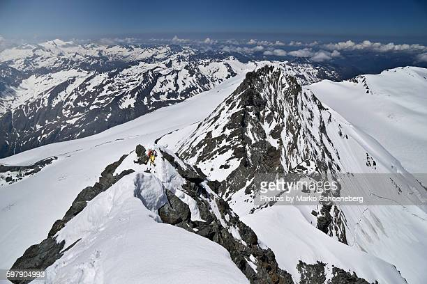 A mountaineer climbs the ridge of Großglockner