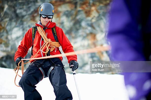 Mountaineer descending snow-covered mountain