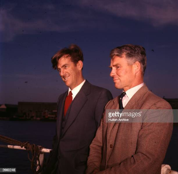 Mountaineer Edmund Hillary and explorer Dr Vivian Fuchs on board the 'Theron' after its return from the Antarctic during the Commonwealth...