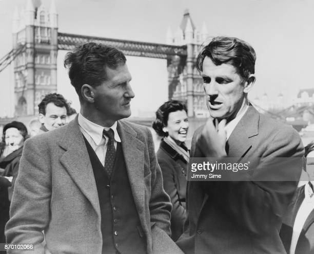 Mountaineer Edmund Hillary talks to fellow explorer Sir John Hunt in the Pool of London after returning from the Antarctic on the vessel 'Theron'...