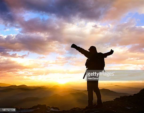 mountaineer enjoying the sunset