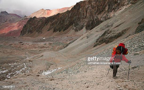 Mountaineer hauling a heavy load between camps on Aconcagua, Andes Mountains, Argentina