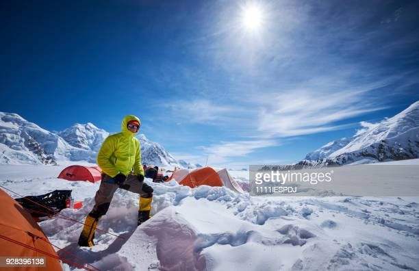 mountaineer in camp 01 on denali. - mt mckinley stock photos and pictures