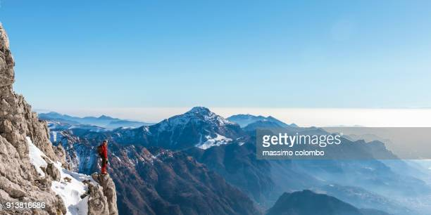 mountaineer looking mountain valley from the top - explorer stock pictures, royalty-free photos & images