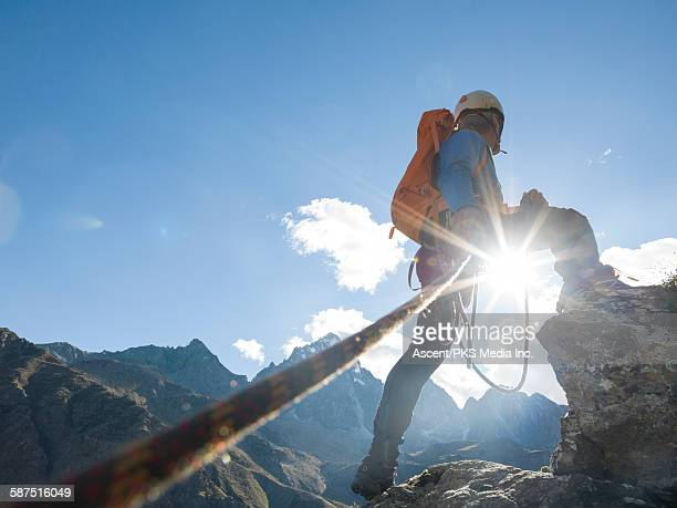 mountaineer looks off to distant mtns, on summit - persistence stock pictures, royalty-free photos & images