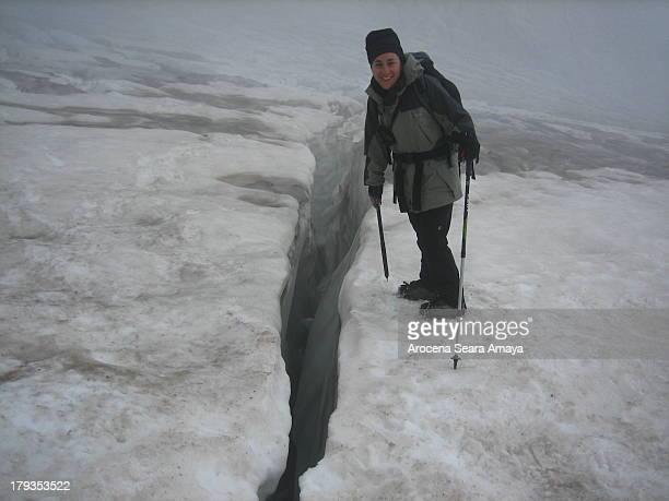 Mountaineer next to a crack in the glacier Ossoue, Vignemale massif . The Vignemale , at 3298 metres, is the highest of the French Pyrenean summits,...