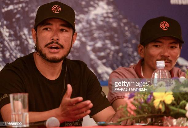 Mountaineer Nirmal Purja speaks and Nepali mountaineer Mingma David Sherpa looks on during a press conference in Kathmandu on May 28 2019 Nirmal...