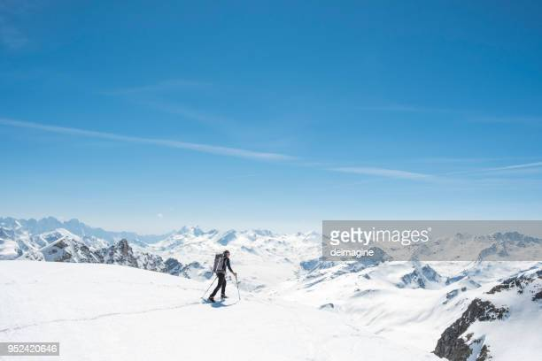 mountaineer on a snow capped majestic valley - switzerland stock pictures, royalty-free photos & images