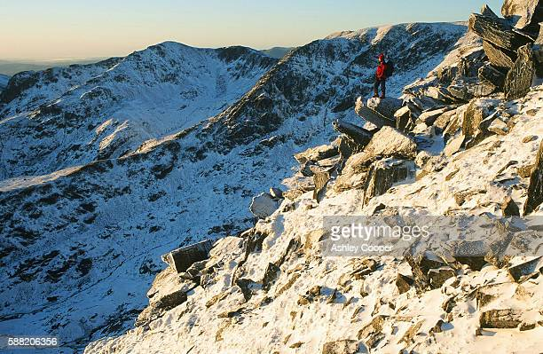 A mountaineer on Striding Edge on Helvellyn in the Lake District UK