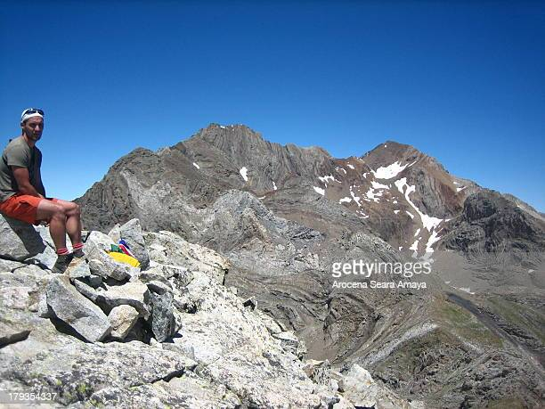 CONTENT] Mountaineer on the peak Forqueta in front Posets peak Pico Posets or Punta de Llardana is the second highest peak of the Pyrenees after...