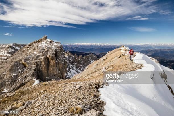 Mountaineer on the way up to the Latemarspitze, behind the summit of Latemarspitz, left the Diamantiniturm, Eggental, Dolomites, South Tyrol Province, Region of Trentino-Alto Adige, Italy